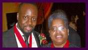 Wyclef Jean — Haitian Musician, Record Producer — Politician with Bishop Dr. Valli [both received AWMF Ribbon and Medallion for Missions work and Support to in 2010]